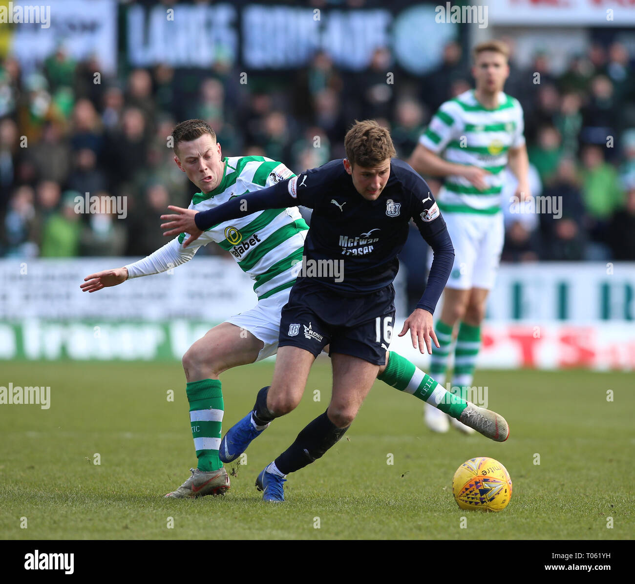 Dundee, UK. 17th Mar, 2019. Ladbrokes Premiership football, Dundee versus Celtic; Callum McGregor of Celtic challenges Ethan Robson of Dundee Credit: Action Plus Sports/Alamy Live News - Stock Image