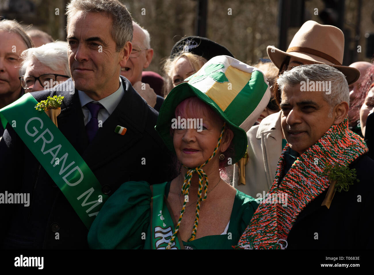 London, UK. 17th March, 2019. The mayor of London, Sadiq Khan, receives a warm scarf in the Irish colours orange, white and green and opens the St Patrick's Day Parade London near Piccadilly, UK, today. Credit: Joe Kuis / Alamy Live News - Stock Image