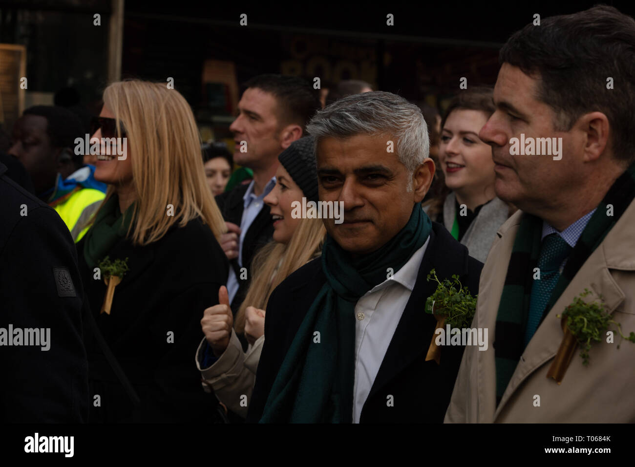 London, UK. 17th March, 2019. Mayor of London, Sadiq Khan, with a green scarf, walks at the front of the St Patrick's Day Parade London near Piccadilly, UK, today. Credit: Joe Kuis / Alamy Live News - Stock Image