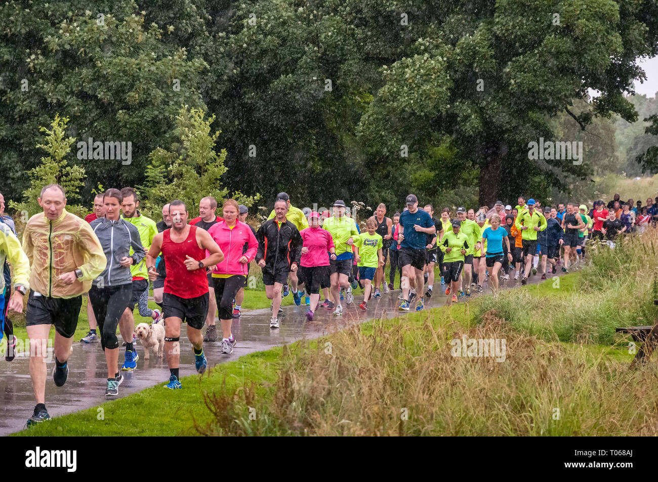 Wet day fun runners - Stock Image