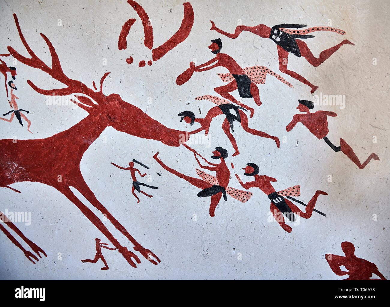 Recontructed fresco of an original found at Catalhoyuk. The men are hunting a deer and pulling on its tounge to disable it. The hunters are believed b Stock Photo
