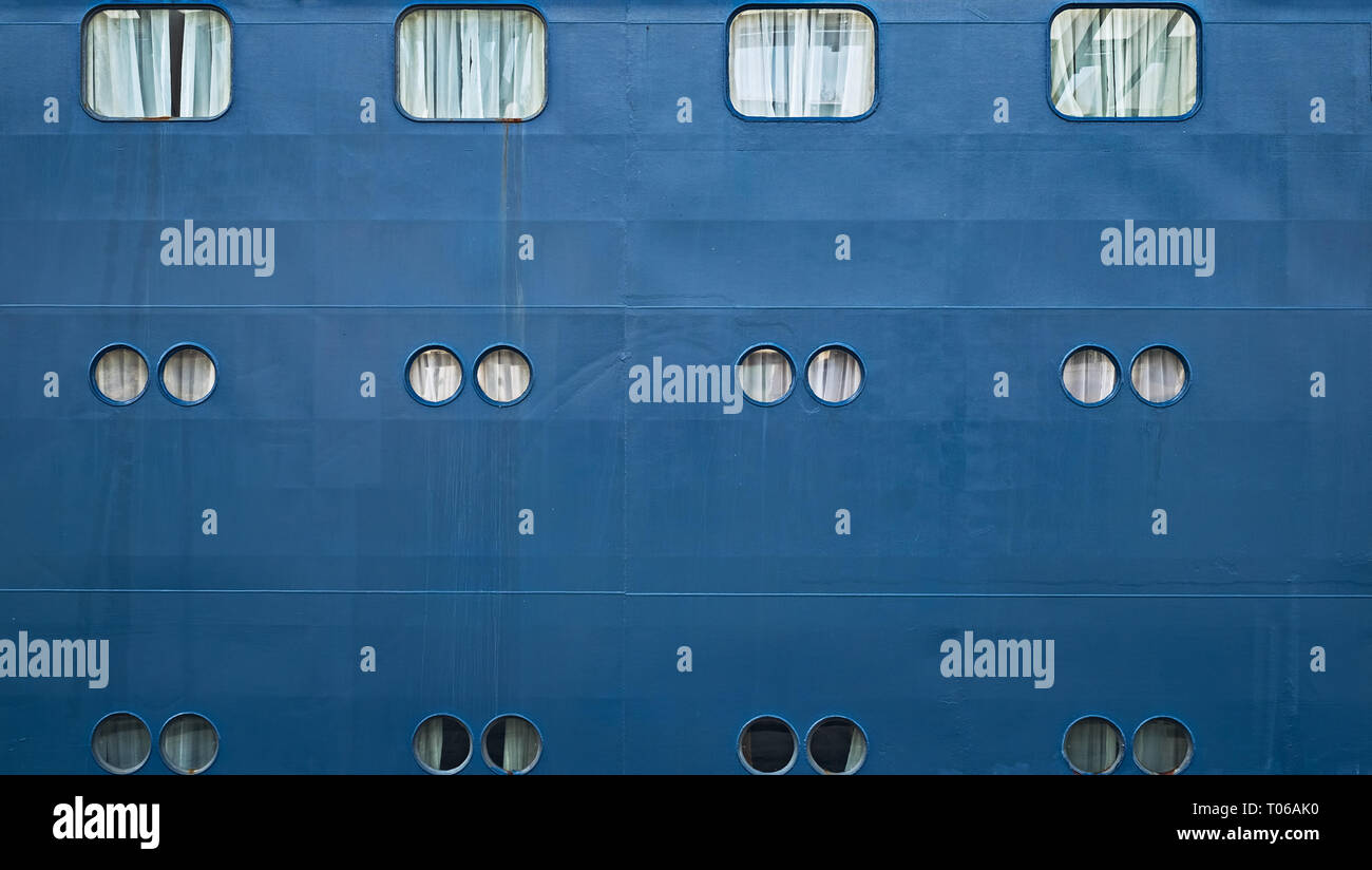 Ship porthole, small windows on ship side - Stock Image