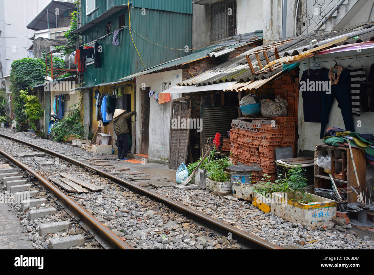 Hanoi, Vietnam - 14th December 2017. Houses on a residential street which is often referred to as Train Street in central Hanoi which has grown up aro Stock Photo