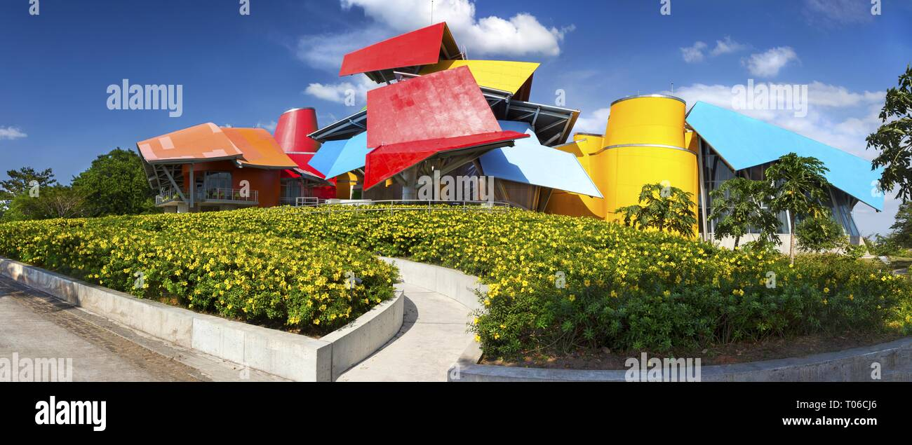 Wide Panoramic View of Biomuseo, a museum of Natural History of Central America, Building Exterior and Flower Garden in Panama City - Stock Image