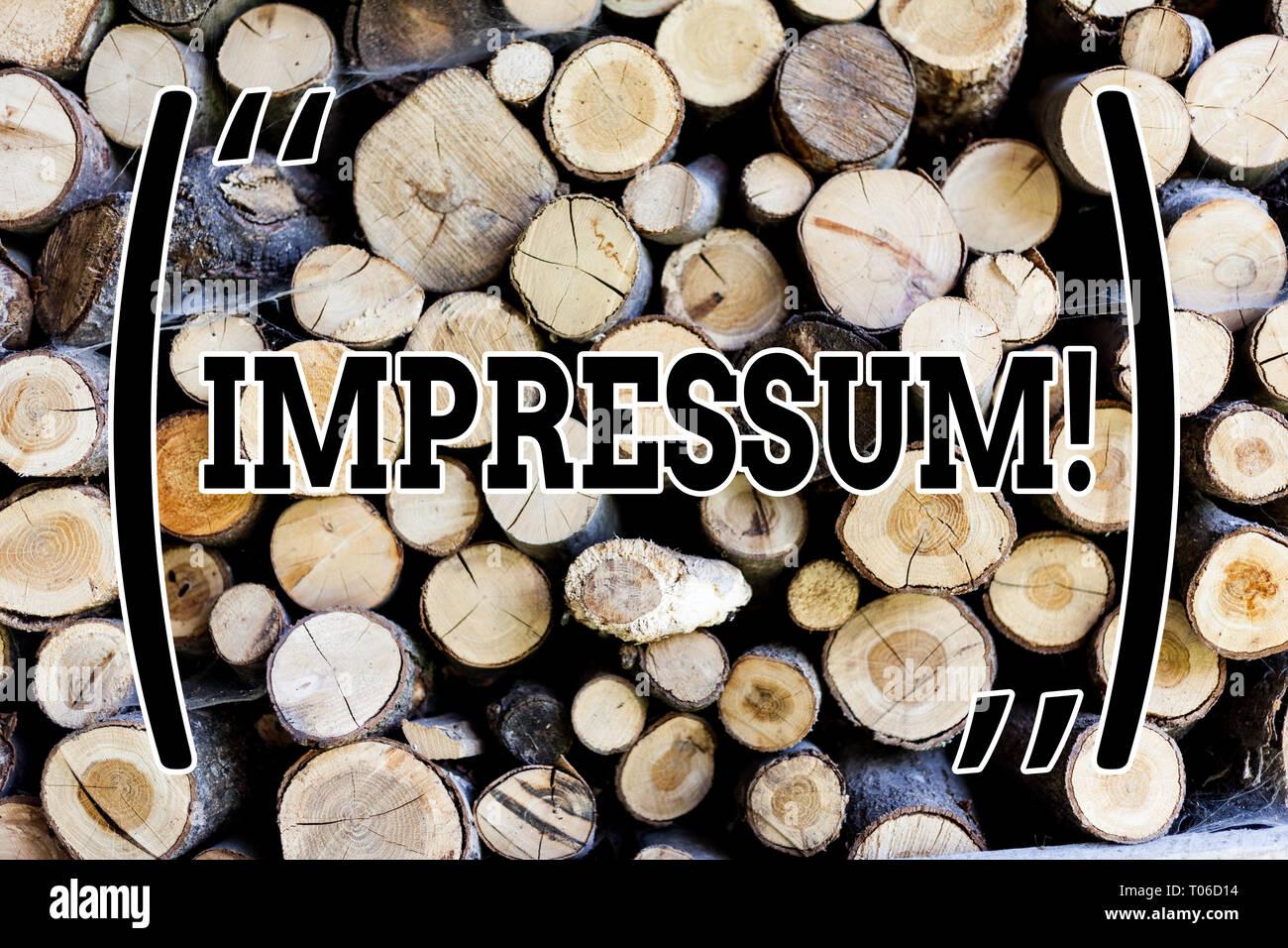 Text sign showing Impressum. Business photo text Impressed Engraved Imprint Geranalysis statement ownership authorship Wooden background vintage wood  - Stock Image