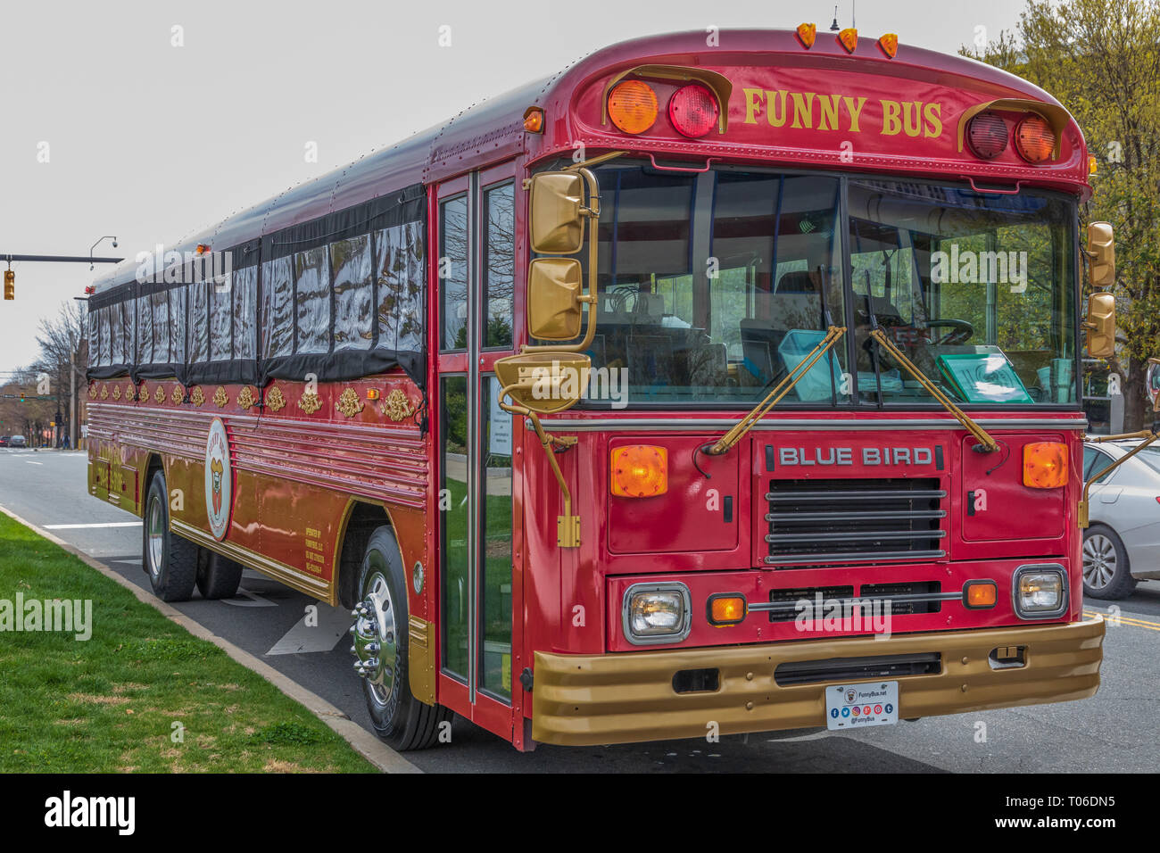CHARLOTTE, NC, USA-3/16/19: A city tour bus, combined with an onboard comedy show, stands idle at First Ward Park. - Stock Image