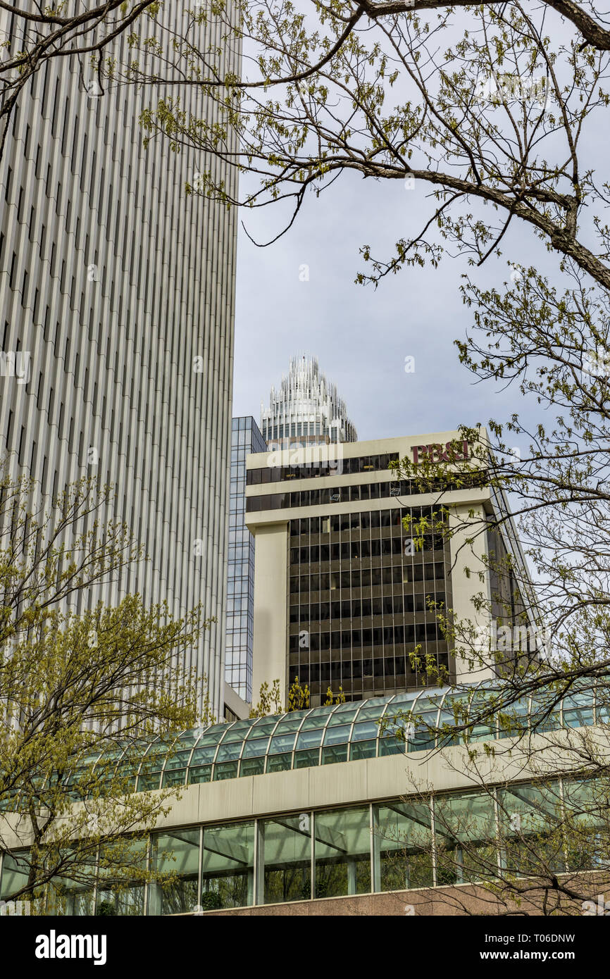 CHARLOTTE, NC, USA-3/16/19: A skyline view of the Charlotte skyline from Martin Luther King Blvd. and College St. in early spring, with new leaves. - Stock Image