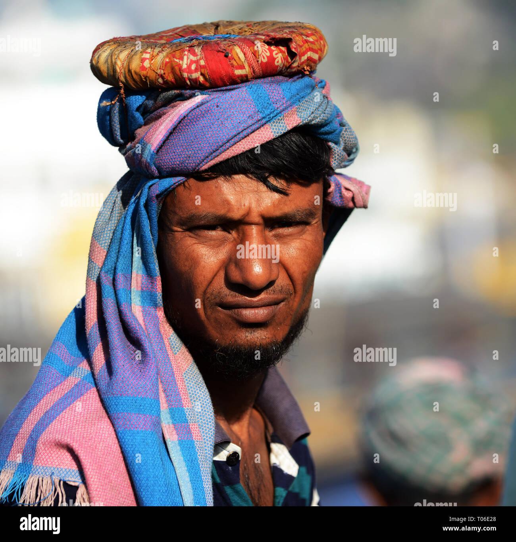 Portrait of a Bangladeshi coal worker. - Stock Image