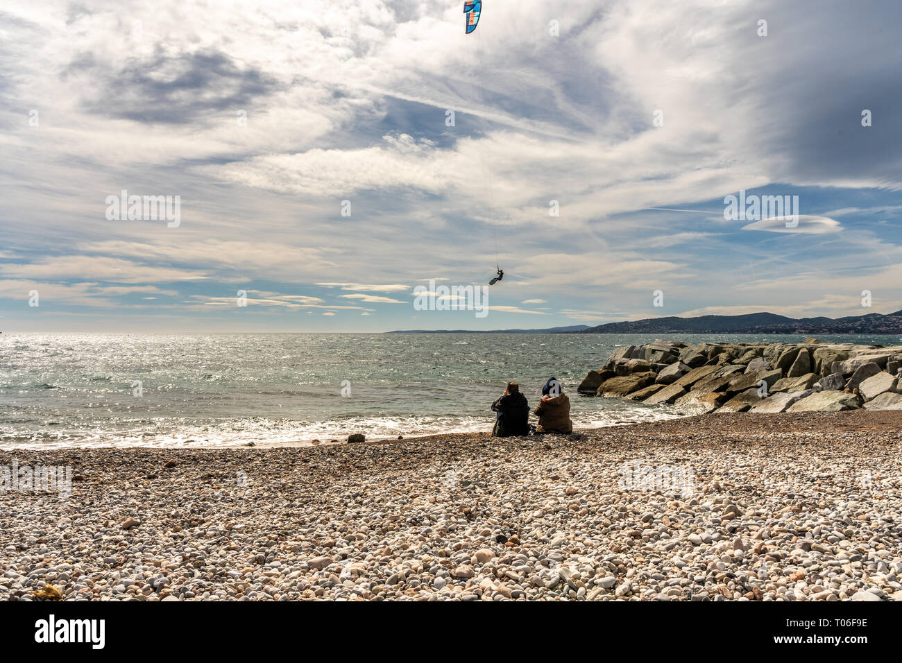 people watching a kite surfer in actionon french riviera in saint raphael, france Stock Photo