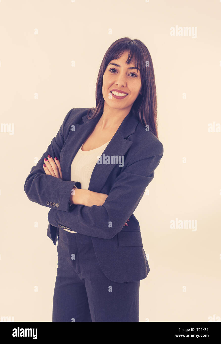 Full length portrait of young beautiful successful businesswoman smiling. Isolated on neutral background. In people, corporate business education, suc Stock Photo