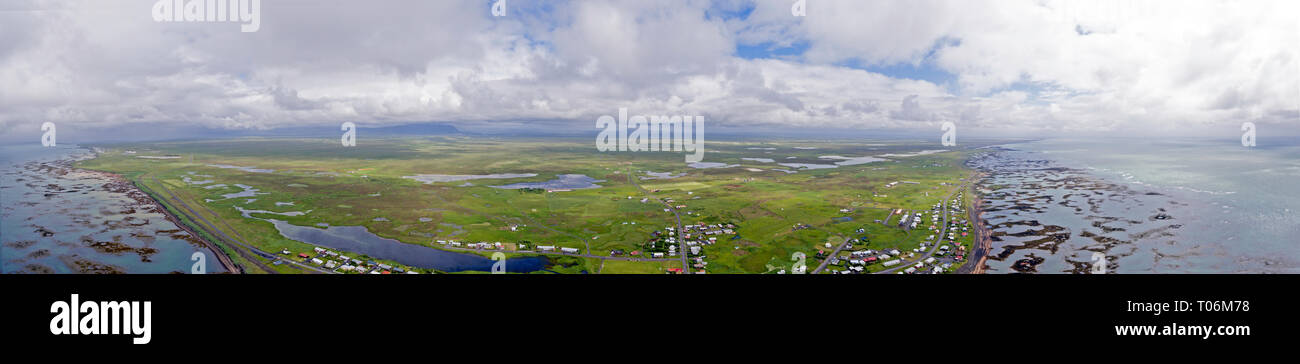 stunning overhead drone shots of the barren and rugged southern iceland coastline and the land, piers and jettys go into the sea. Stock Photo