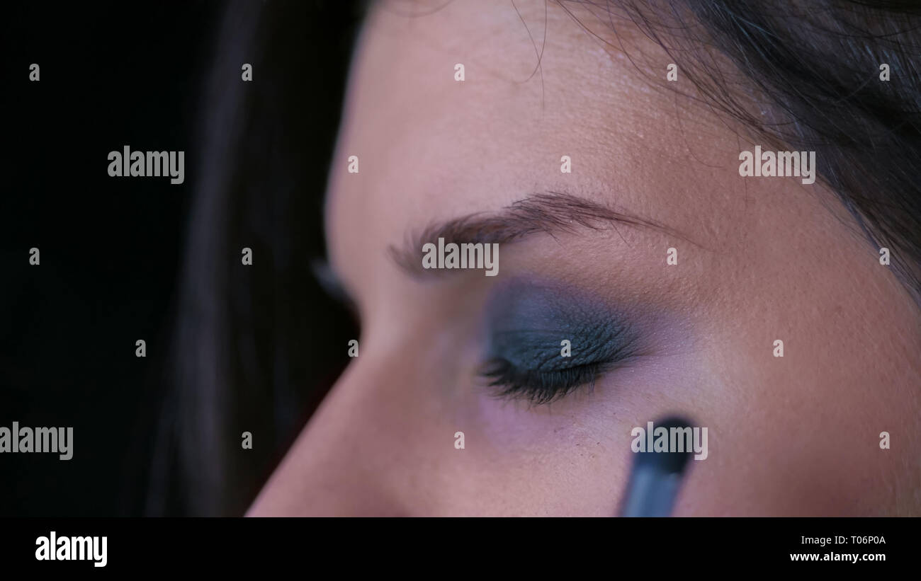 Professional make-up artist applying eyeshadow - Stock Image