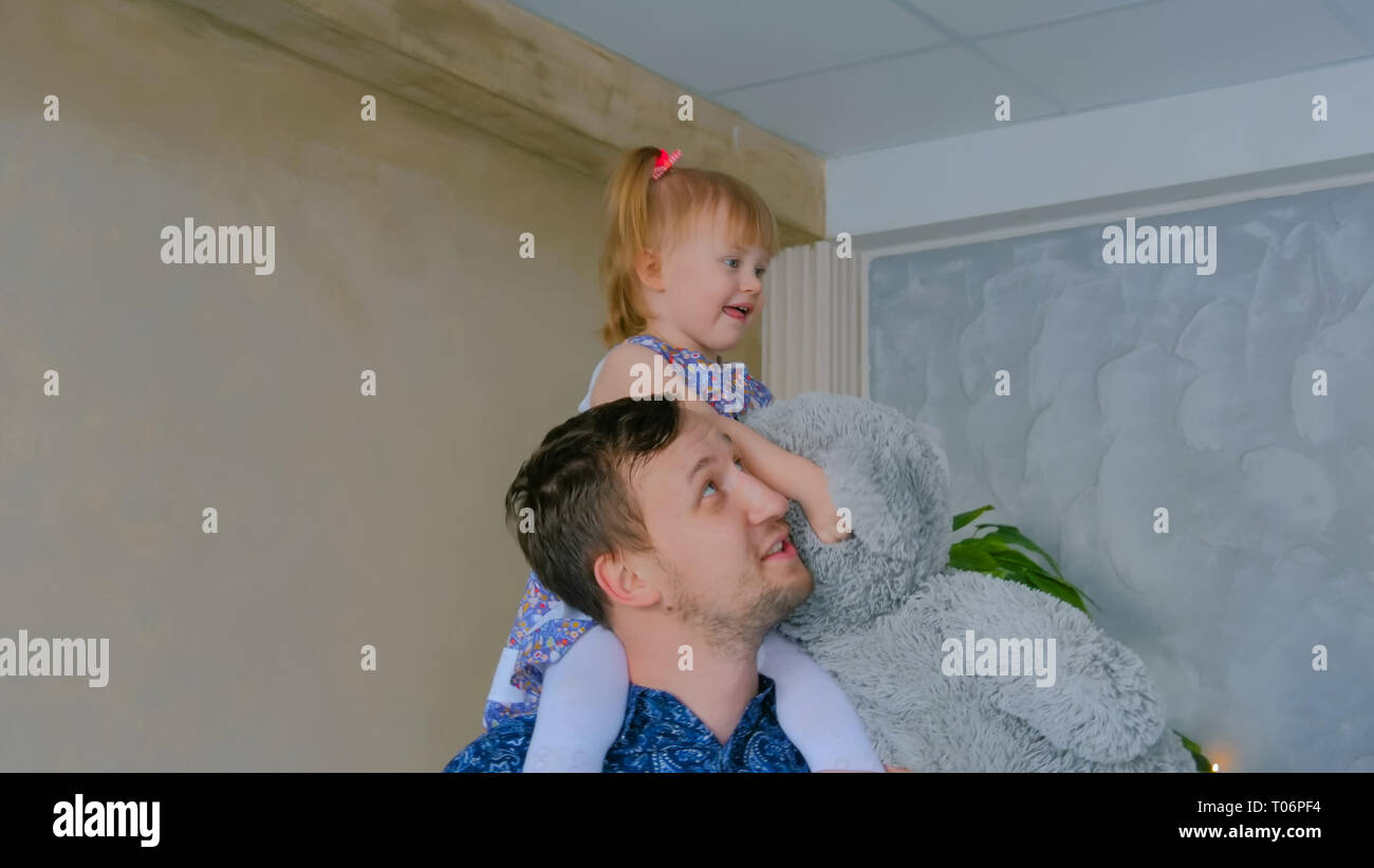 Portrait of funny little girl and her father at home Stock Photo