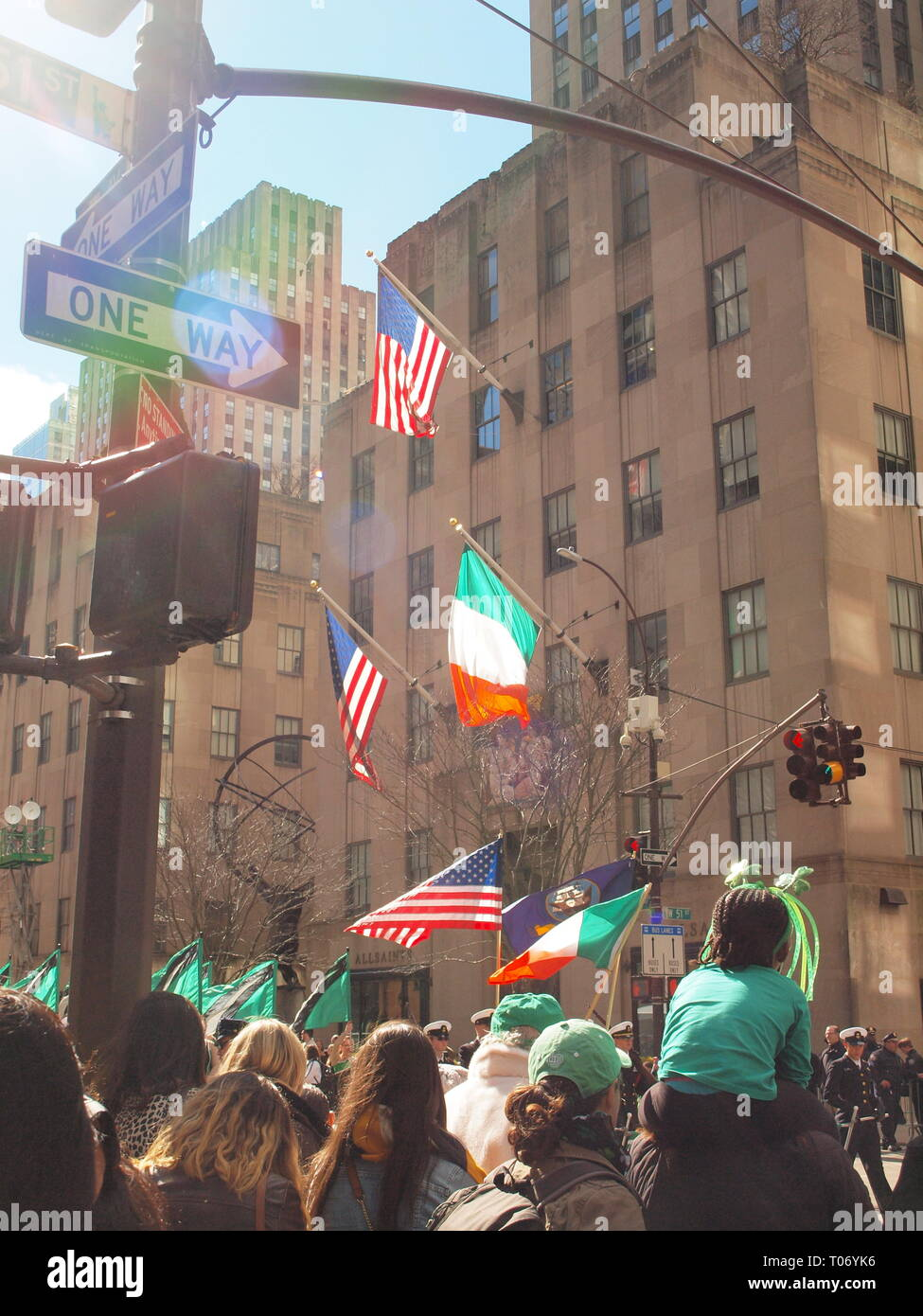Onlookers at the 2019 St. Patrick's Day parade in New York City. Held since 1762, it is the oldest parade in the US. - Stock Image