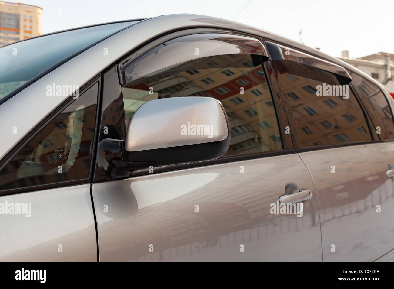 Novosibirsk, Russia - 03.10.2019: View of side rear view mirror and doors deflectors Toyota Ipsum last generation in silver color after cleaning befor - Stock Image