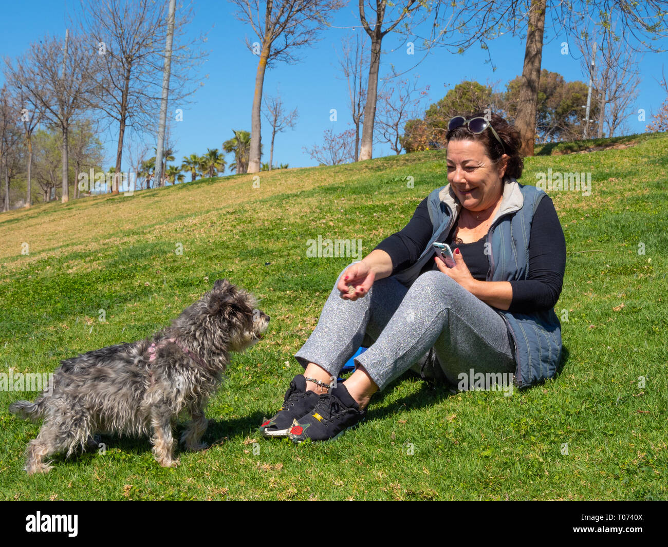 woman playing with her dog - Stock Image