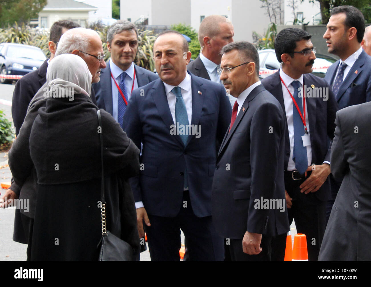 Christchurch, New Zealand. 18th Mar, 2019. Mevlüt Cavusoglu (centre l), Foreign Minister of Turkey, and Fuat Oktay (centre r), Vice-President of Turkey, visit a mosque to commemorate the victims of the attack. The massacre with at least 50 fatalities in two mosques in Christchurch, New Zealand, is apparently the fault of a racist. Credit: Peter Godfrey/dpa/Alamy Live News - Stock Image