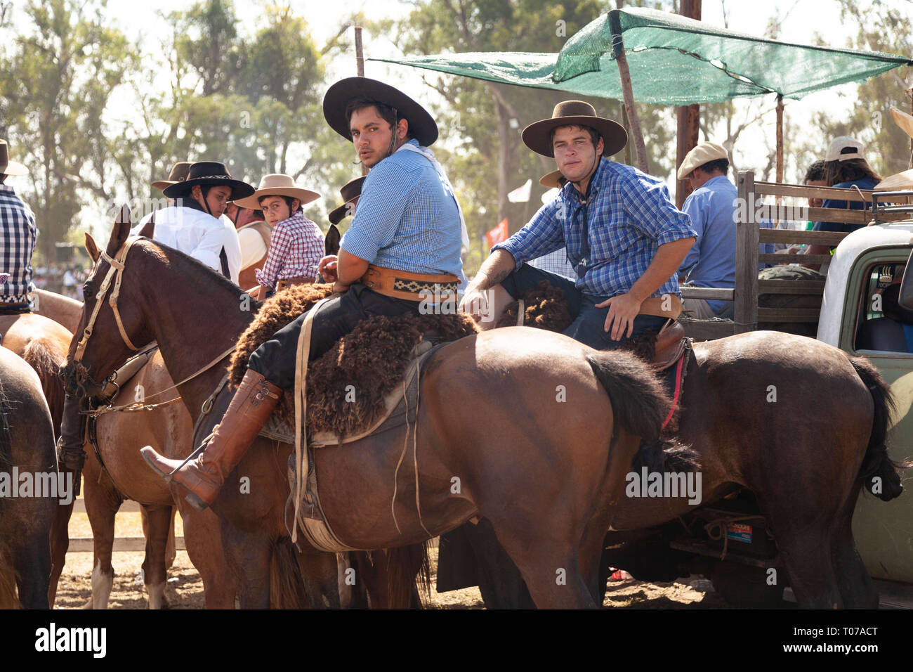 Tacuarembo, Uruguay. 16th Mar, 2019. Local spectators watch the Rodeo riding their horses during the ''Patria Gaucha'' in Tacuarembo.Every March, for 33 years now in Tacuarembó, a town 400 kilometers from Montevideo, the Capital of Uruguay, is celebrated the most important event in the country, ''La Patria Gaucha'' (The Gaucho Homeland) The event lasts six days, and calls more than fifty thousand people from all over the country and the world. Four thousand riders meet to parade down the main street of the town and the best of them compete for the first prize at the horse rodeo. ''La Patri - Stock Image