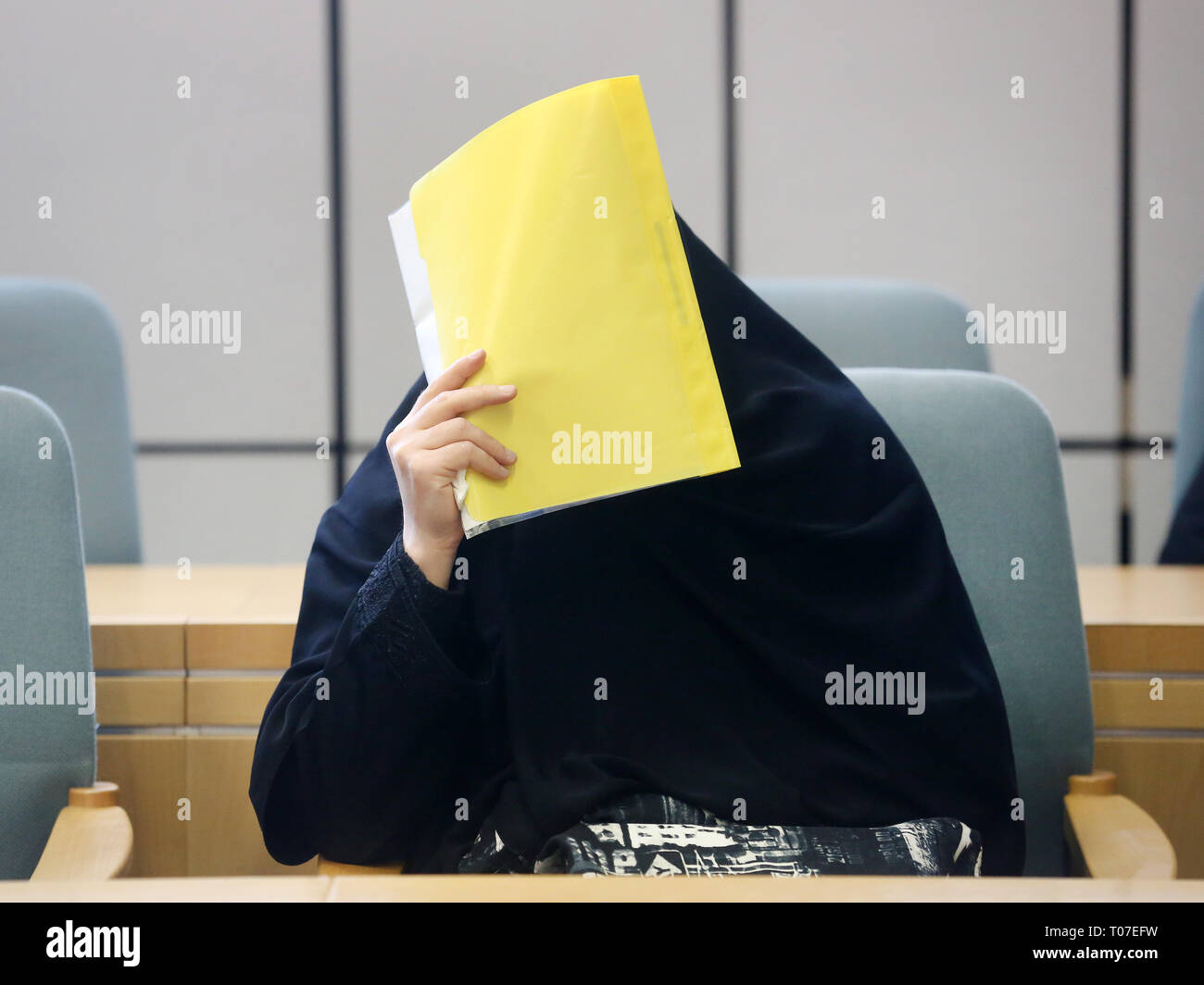 Essen, Germany. 18th Mar, 2019. The defendant was at the beginning of the trial. The 35-year-old woman is accused of stabbing her husband with a bread knife. The charge is manslaughter. Credit: Roland Weihrauch/dpa/Alamy Live News - Stock Image