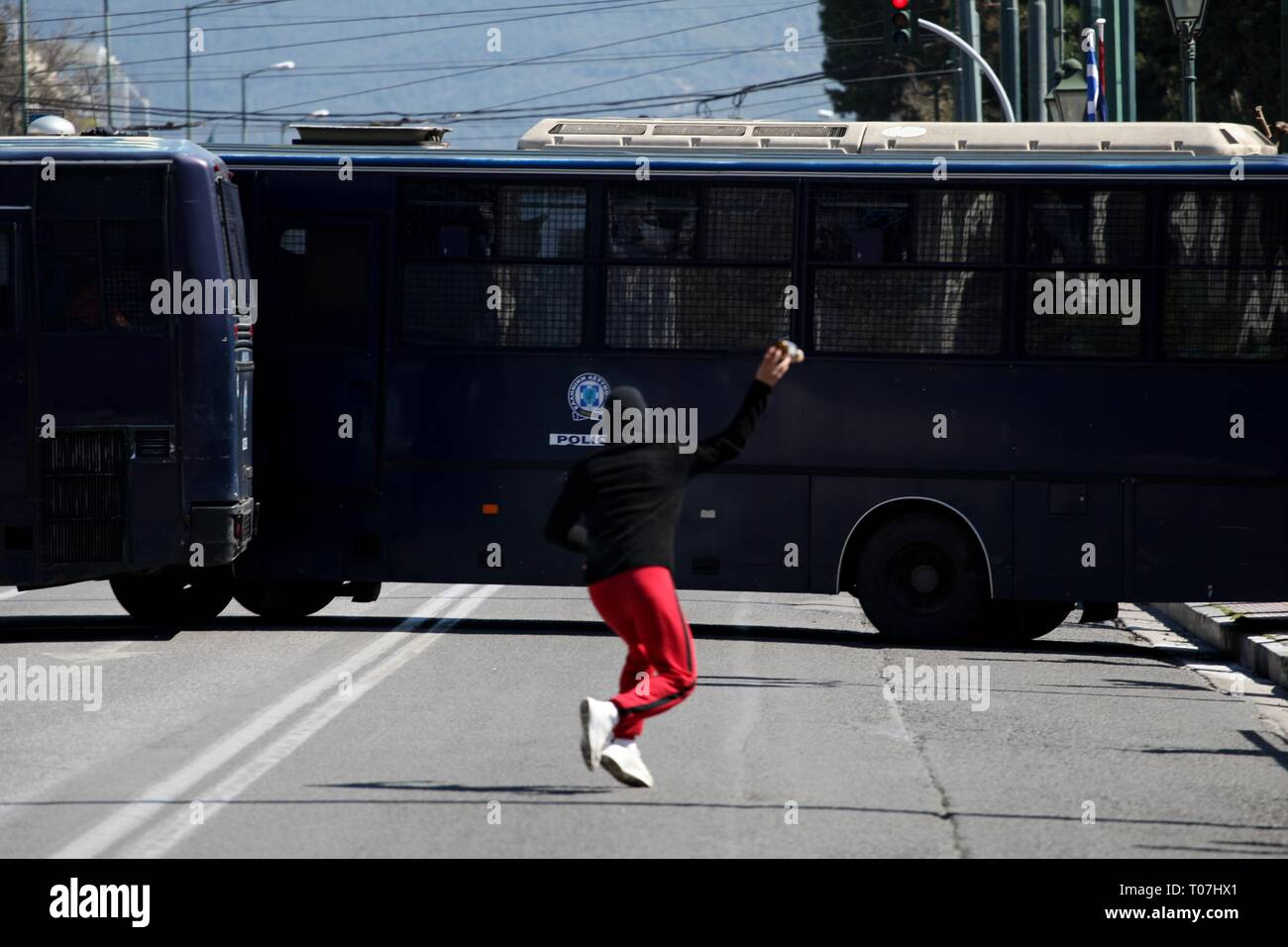 Athens, Greece. 18th Mar, 2019. High-school students throw petrol bombs against riot police during protest in the center of Athens. (Credit Image: © Aristidis VafeiadakisZUMA Wire) Credit: ZUMA Press, Inc./Alamy Live News - Stock Image