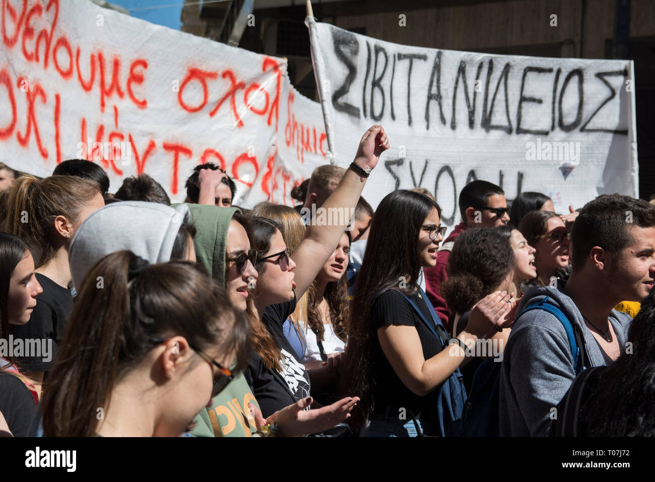 Students rally holding banners and shout slogans against the
