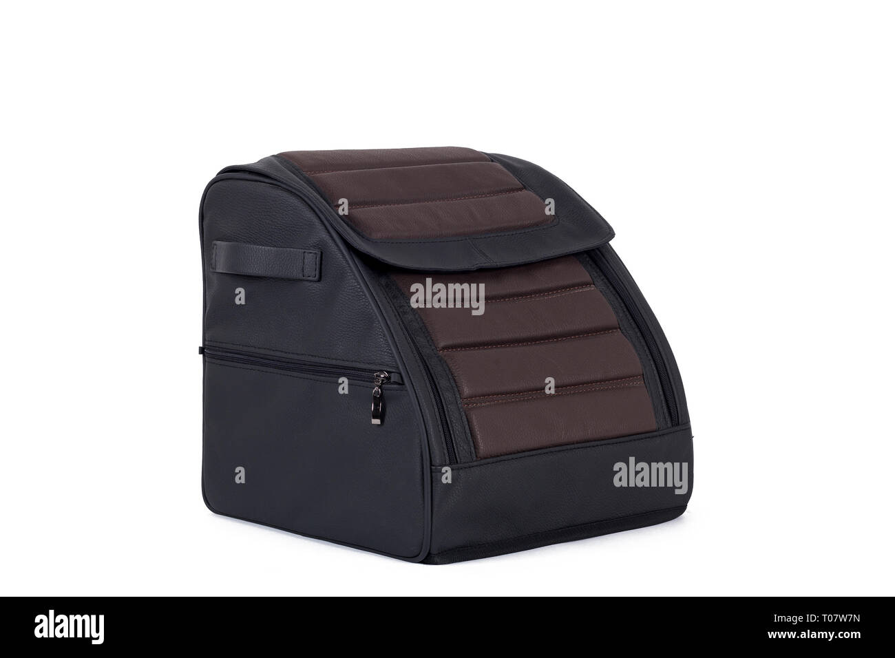 Black-brown  leather bag for storing things and traveling in the trunk of a car on a white isolated background. Luggage, handmade suitcase - Stock Image