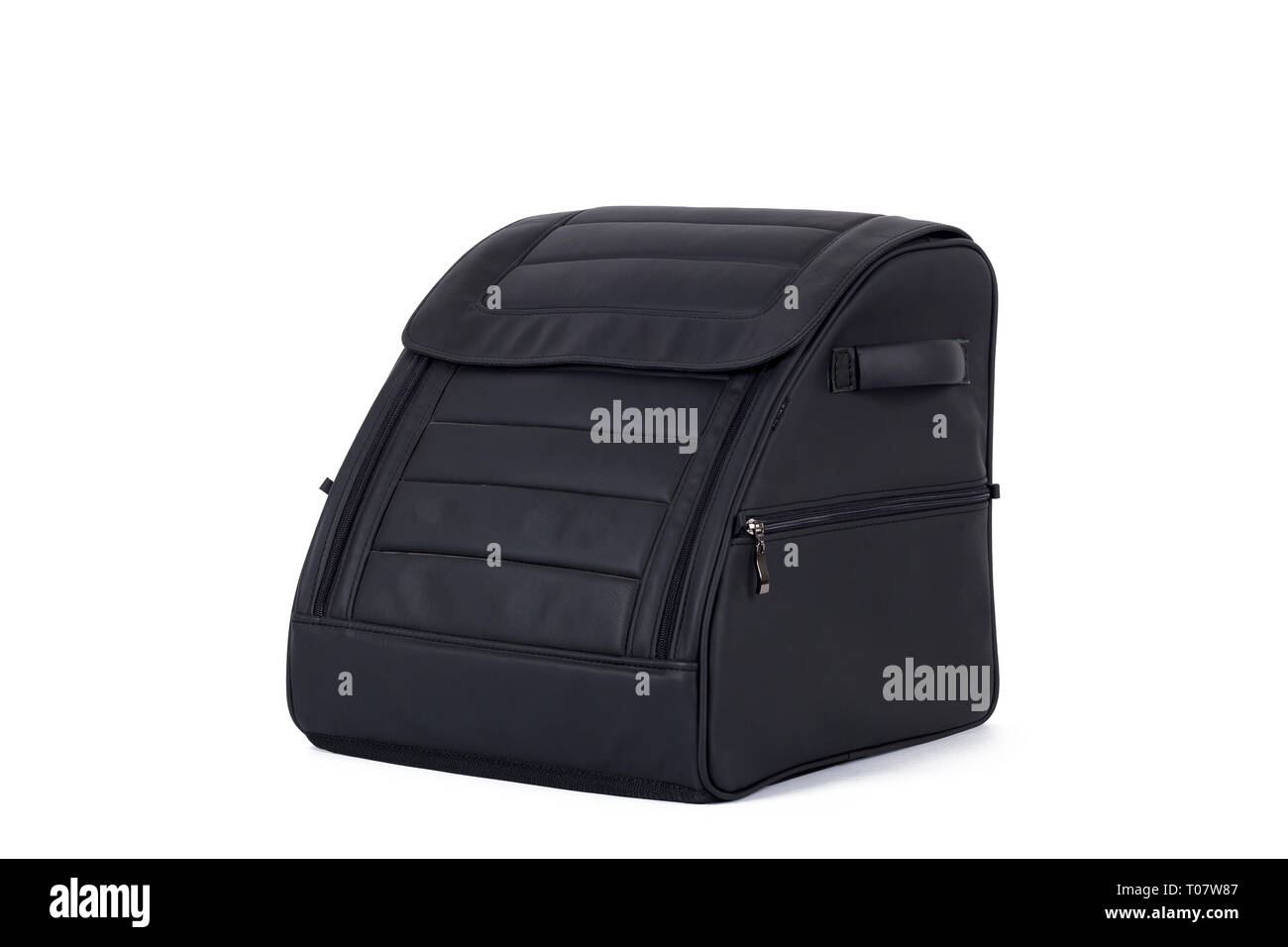 Black  leather bag for storing things and traveling in the trunk of a car on a white isolated background. Luggage, handmade suitcase - Stock Image