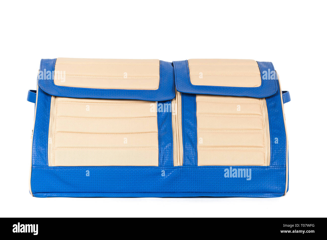 Blue-beige leather bag for storing things and traveling in the trunk of a car on a white isolated background. Luggage, handmade suitcase - Stock Image
