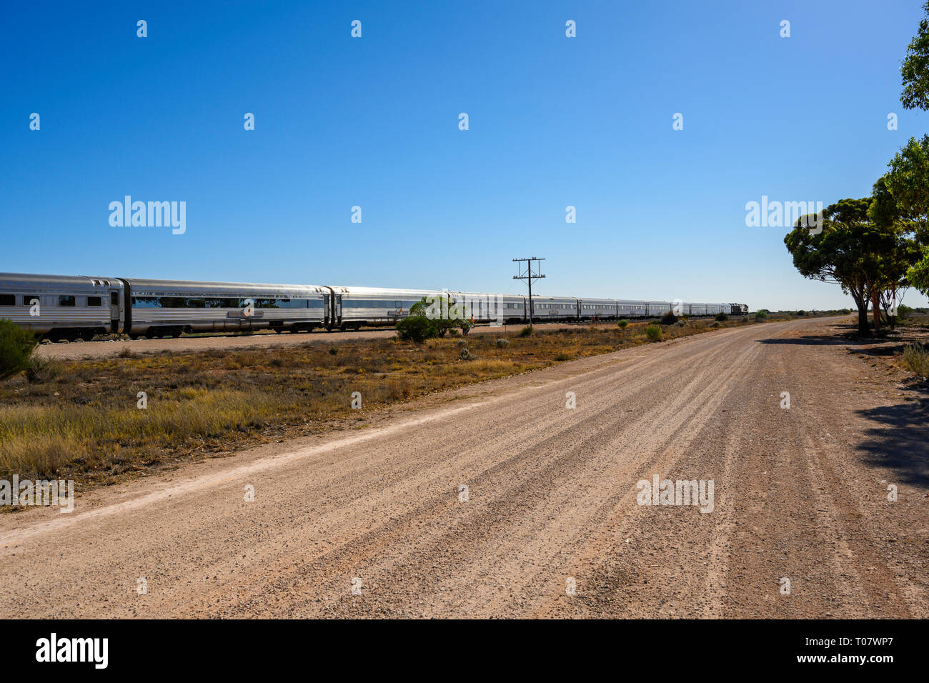 The Indian Pacific train service between Perth and Sydney, Australia, is seen at a stop at Rawlinna, Western Australia. Stock Photo
