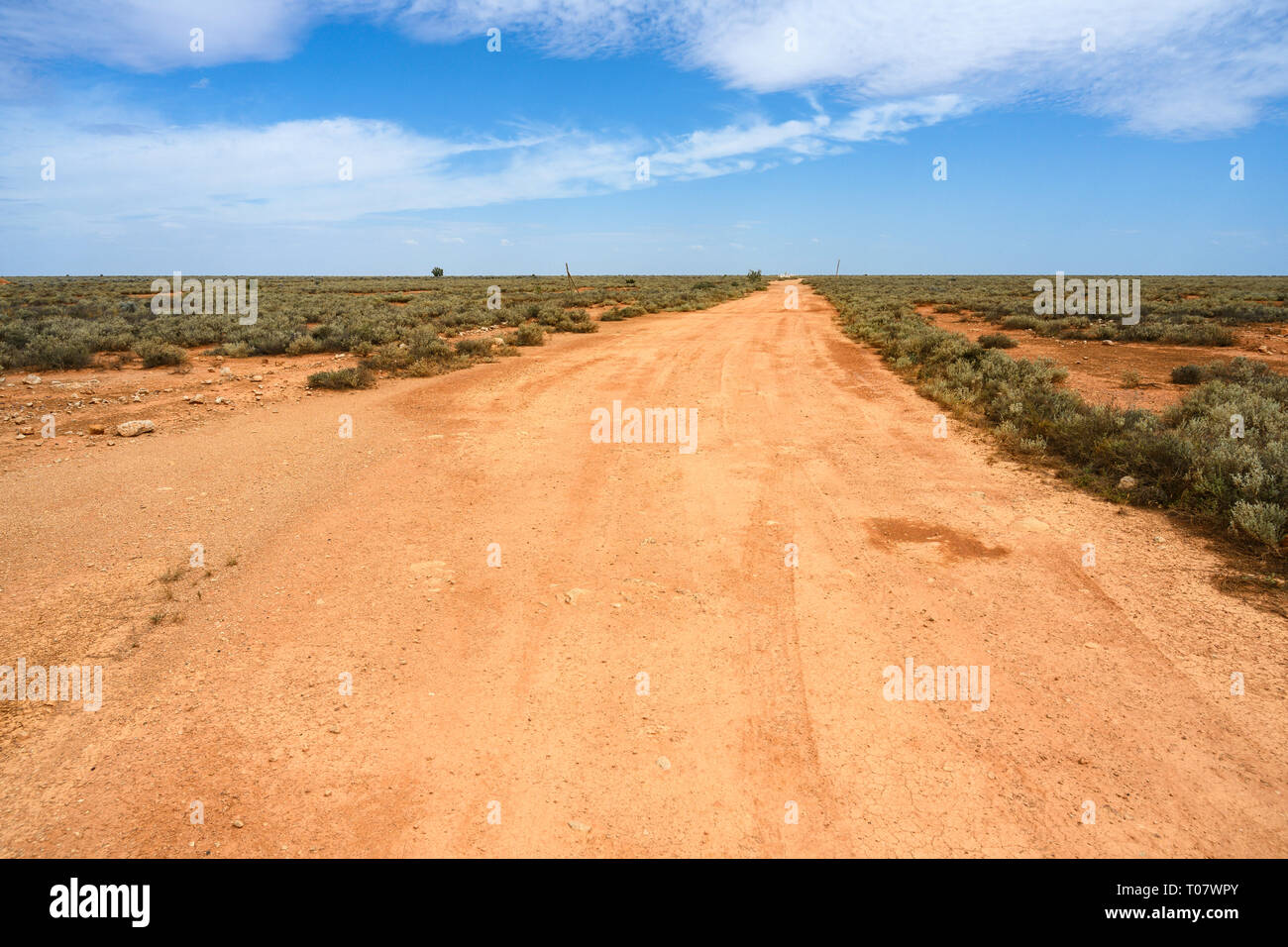 Unsealed gravel road at Cook, South Australia, a former railway town on the Nullarbor Plain that was largely abandoned in 1997. Stock Photo