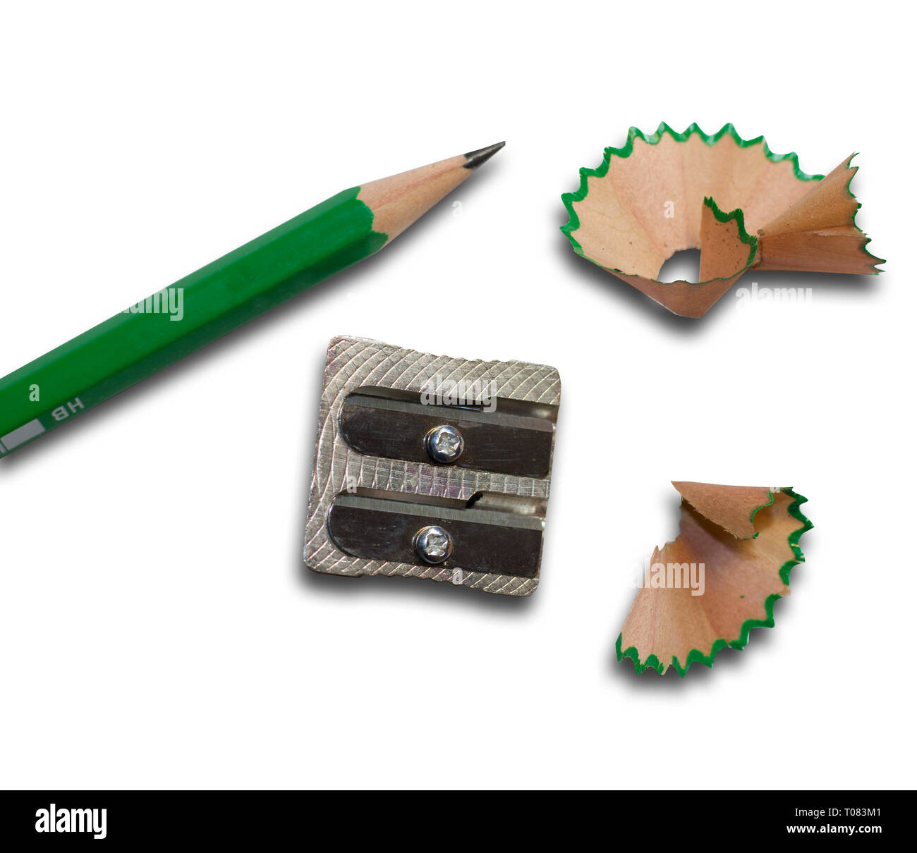 A pencil and a sharpener with pencil shavings - Stock Image