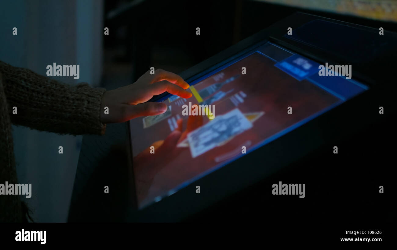 Woman using interactive touchscreen display - Stock Image