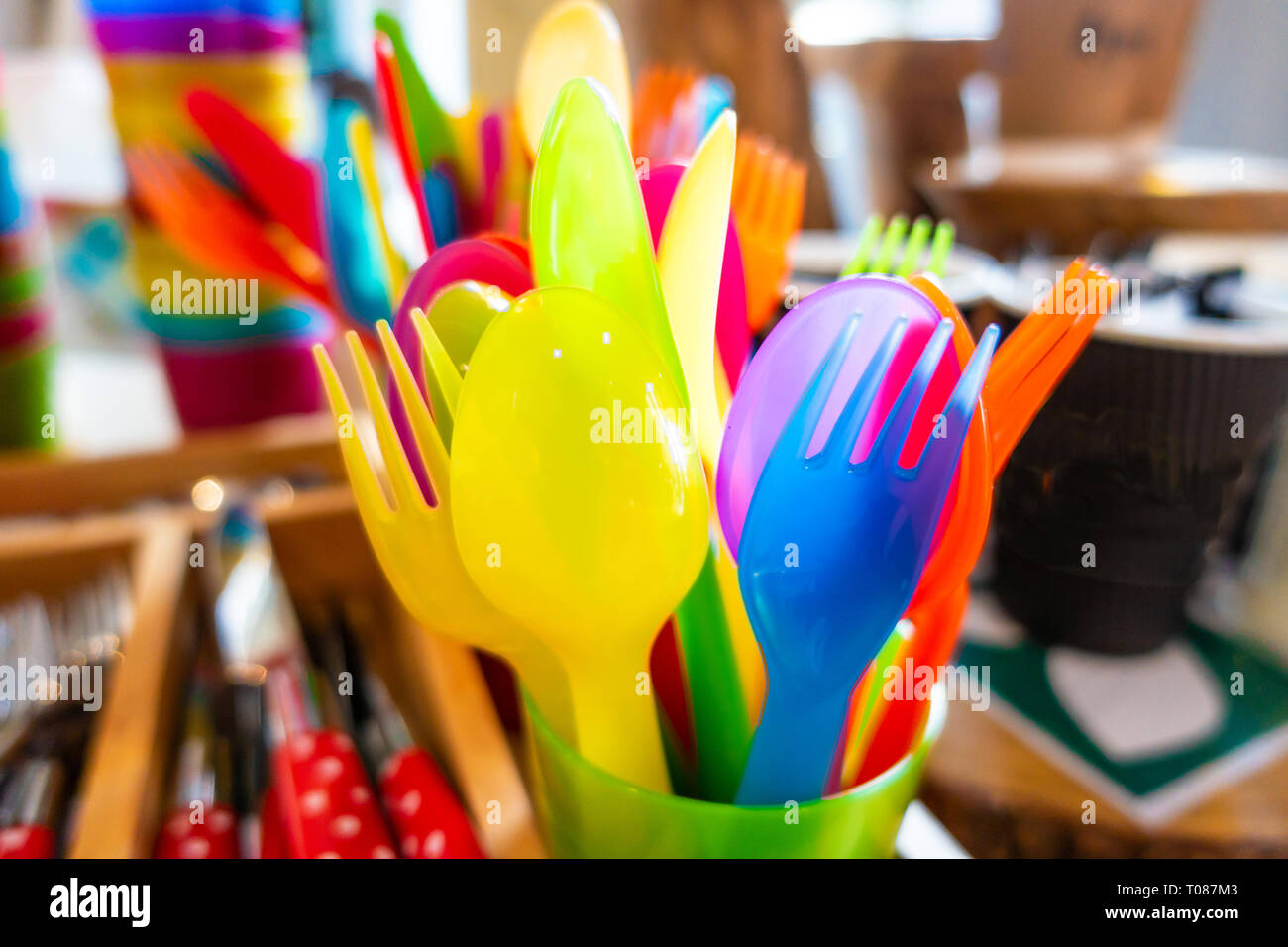 Colourful child safe plastic cutlery - Stock Image