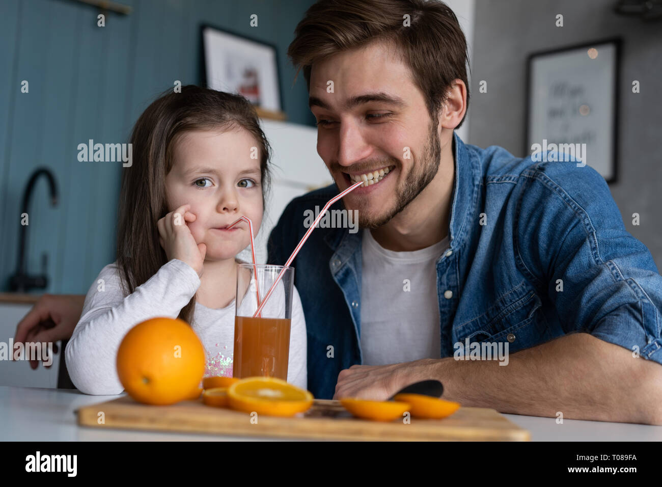 family, eating and people concept - happy father and daughter having breakfast at home Stock Photo