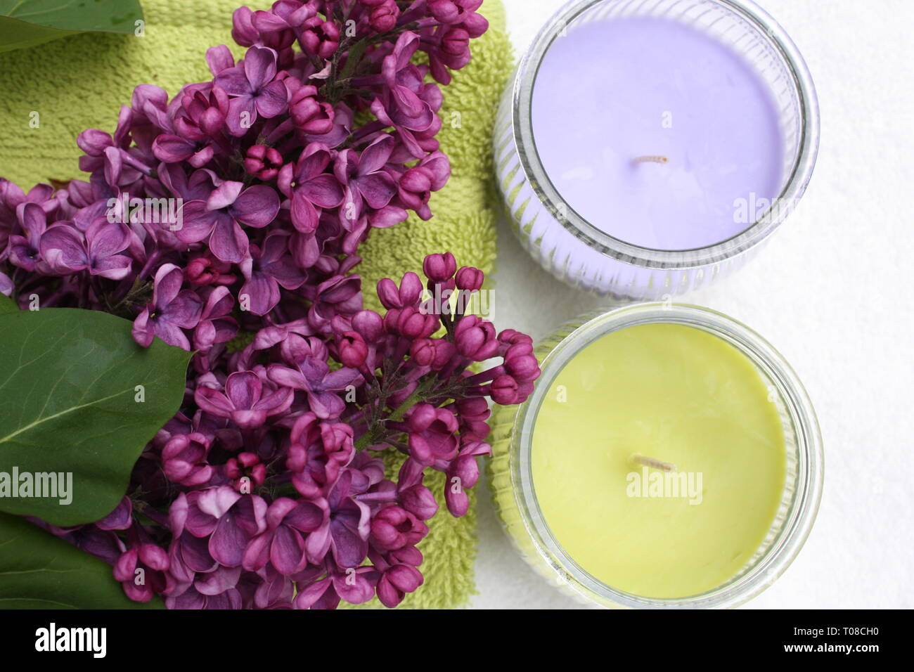 Purple syringa flowers with candles Stock Photo