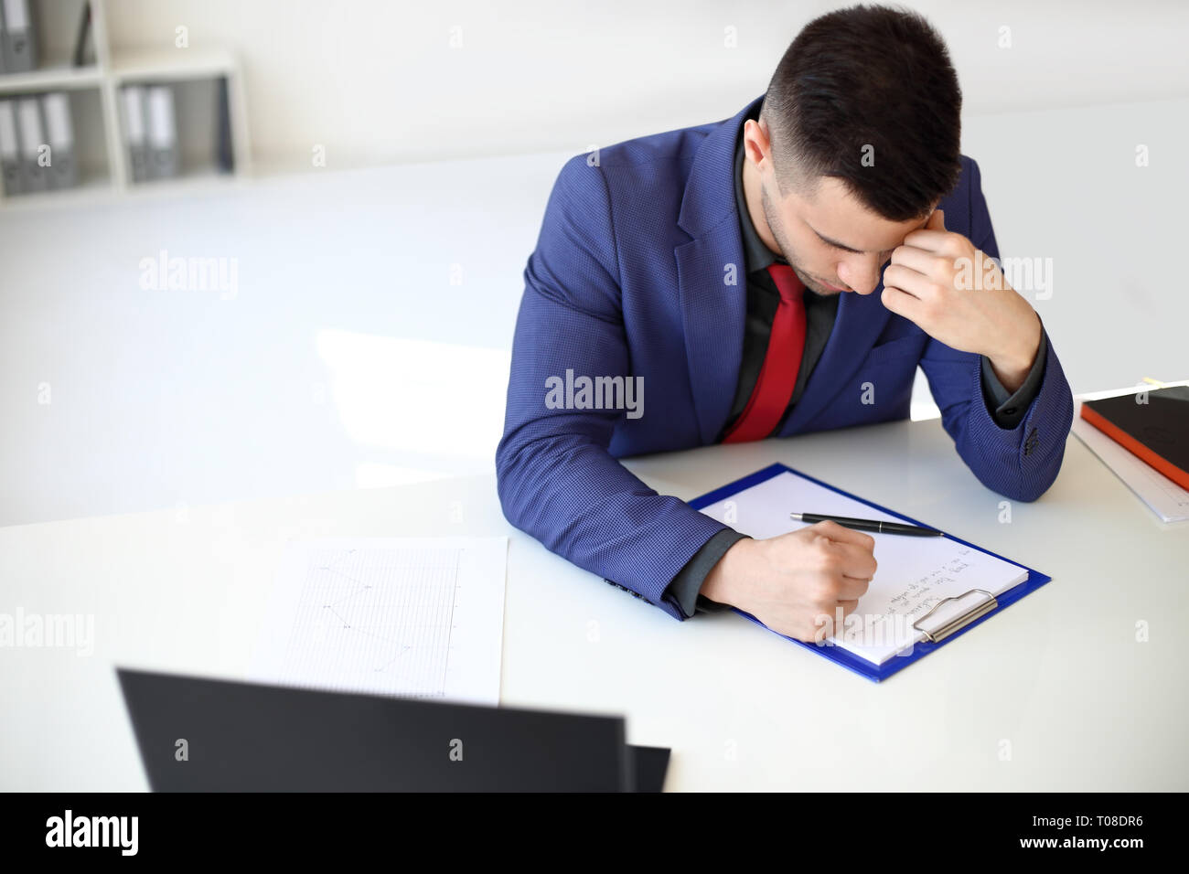 Tired and stressful businessman at work. Depression concept - Stock Image