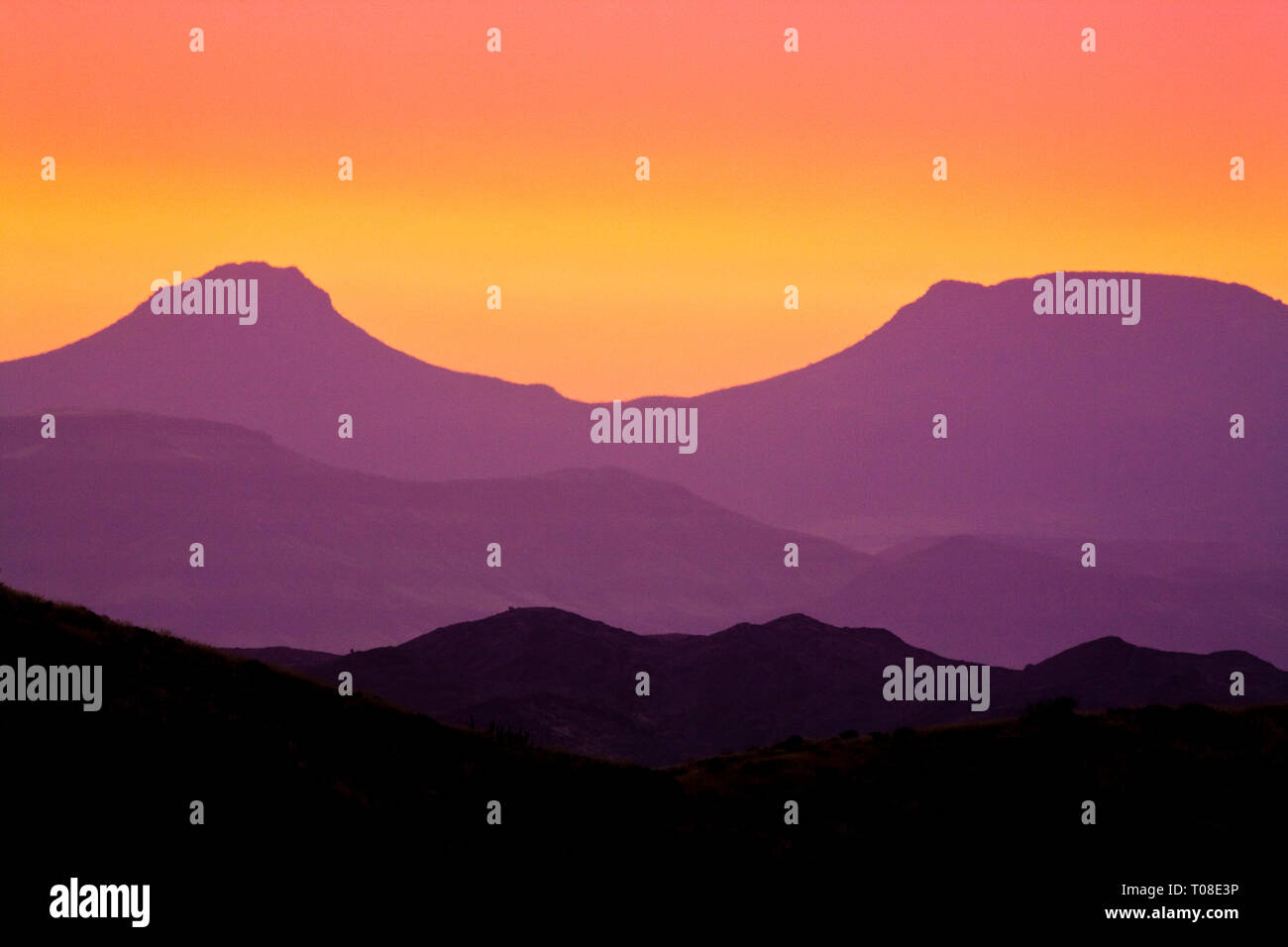 Africa, Namibia, Damaraland. Desert mountains at sunset. - Stock Image