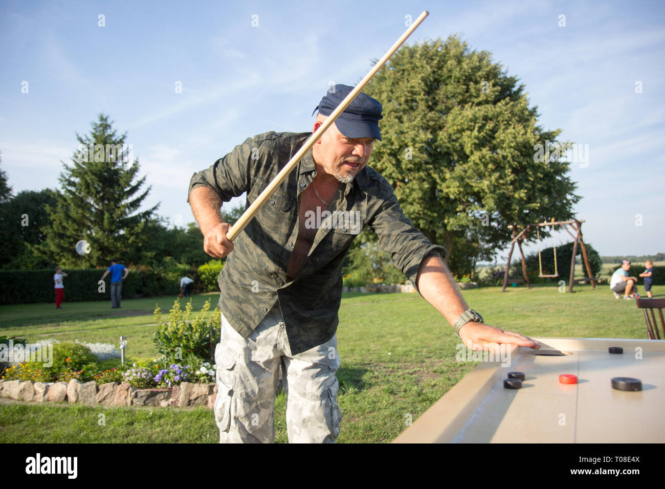Man playing Novuss in outdoors - Stock Image