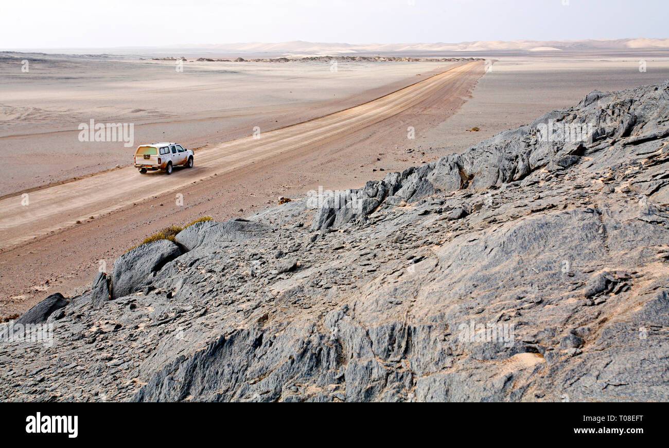 Africa, Namibia, Skeleton Coast.  The road to nowhere, the only road for hundreds of miles through the desolate northernmost region of the Kalahari. - Stock Image