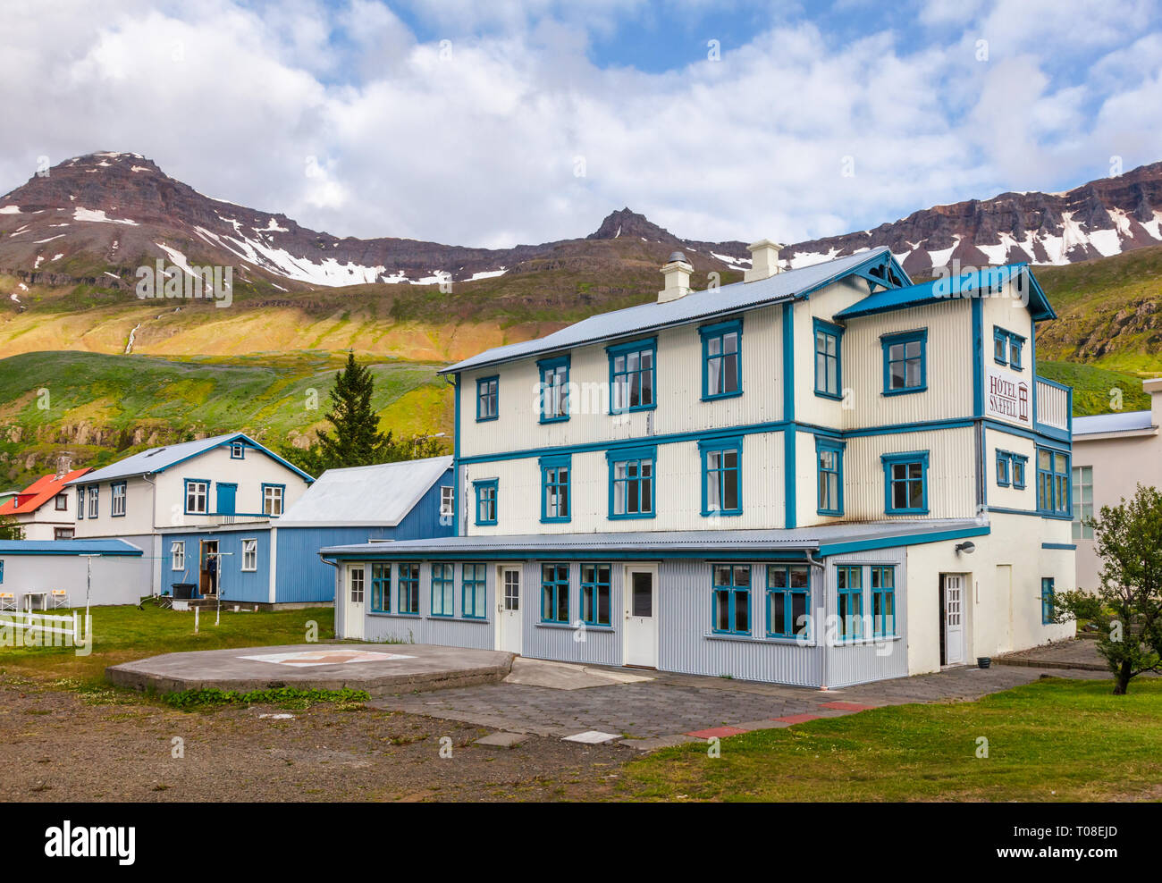 Seydisfjordur, Iceland - Aug 1, 2015: White and blue building of former post office (1908) now Hotel Snæfell on Austurvegur street - Stock Image