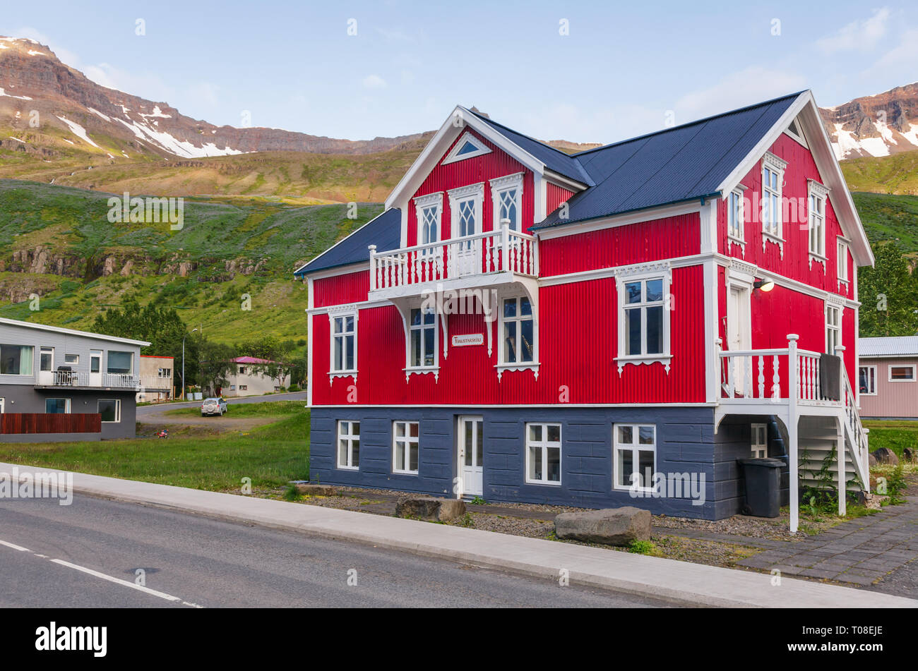 Seydisfjordur, Iceland - Aug 1, 2015: White and red building of music school on Austurvegur street - Stock Image