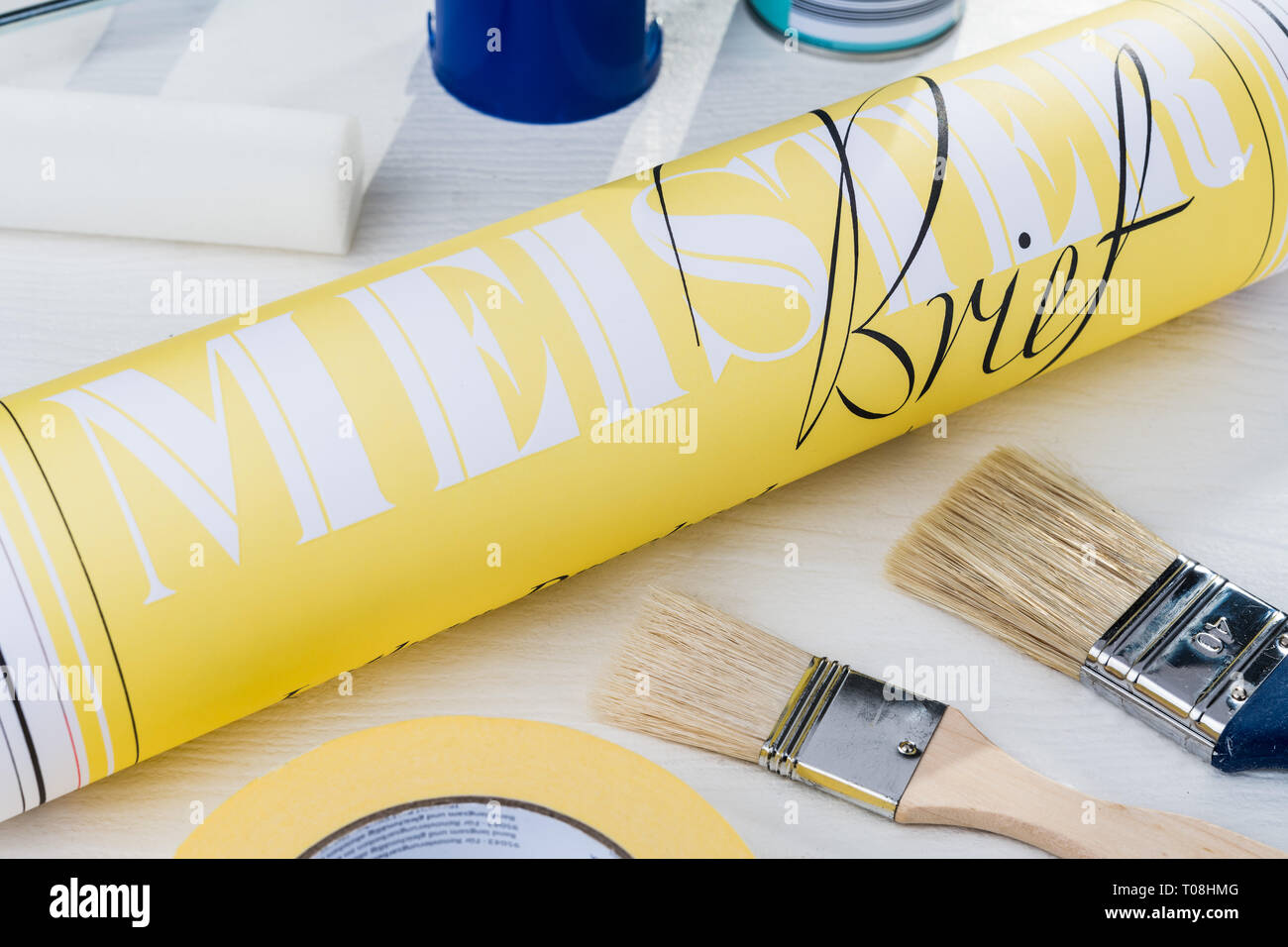 master craftsman's certificate on table with Painter, master painter, brush, paint roller, paint can, adhesive tape, paint, paintbrush, Stock Photo