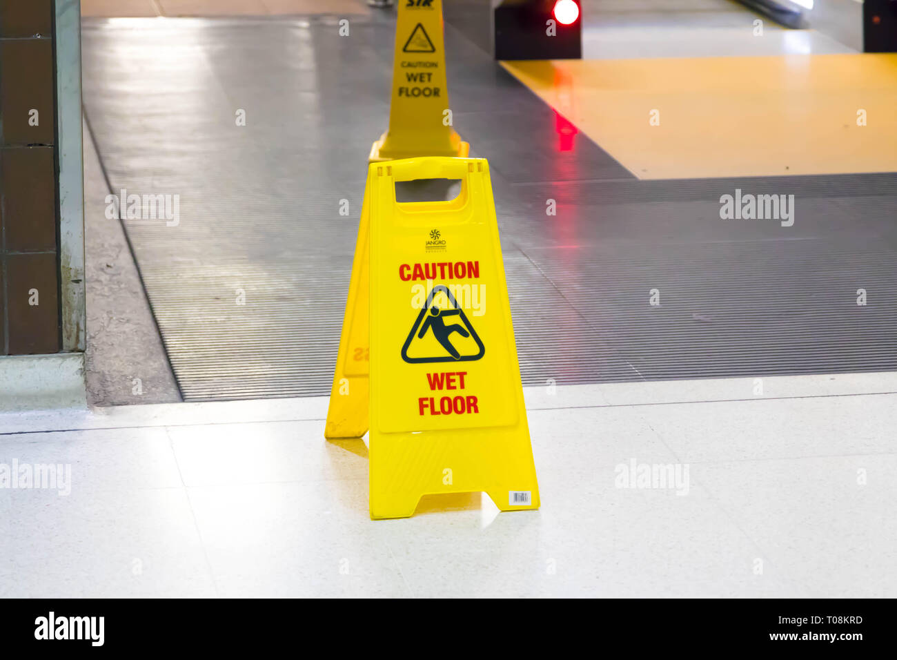 Wet floor yellow sign at Birmingham train station International - Stock Image