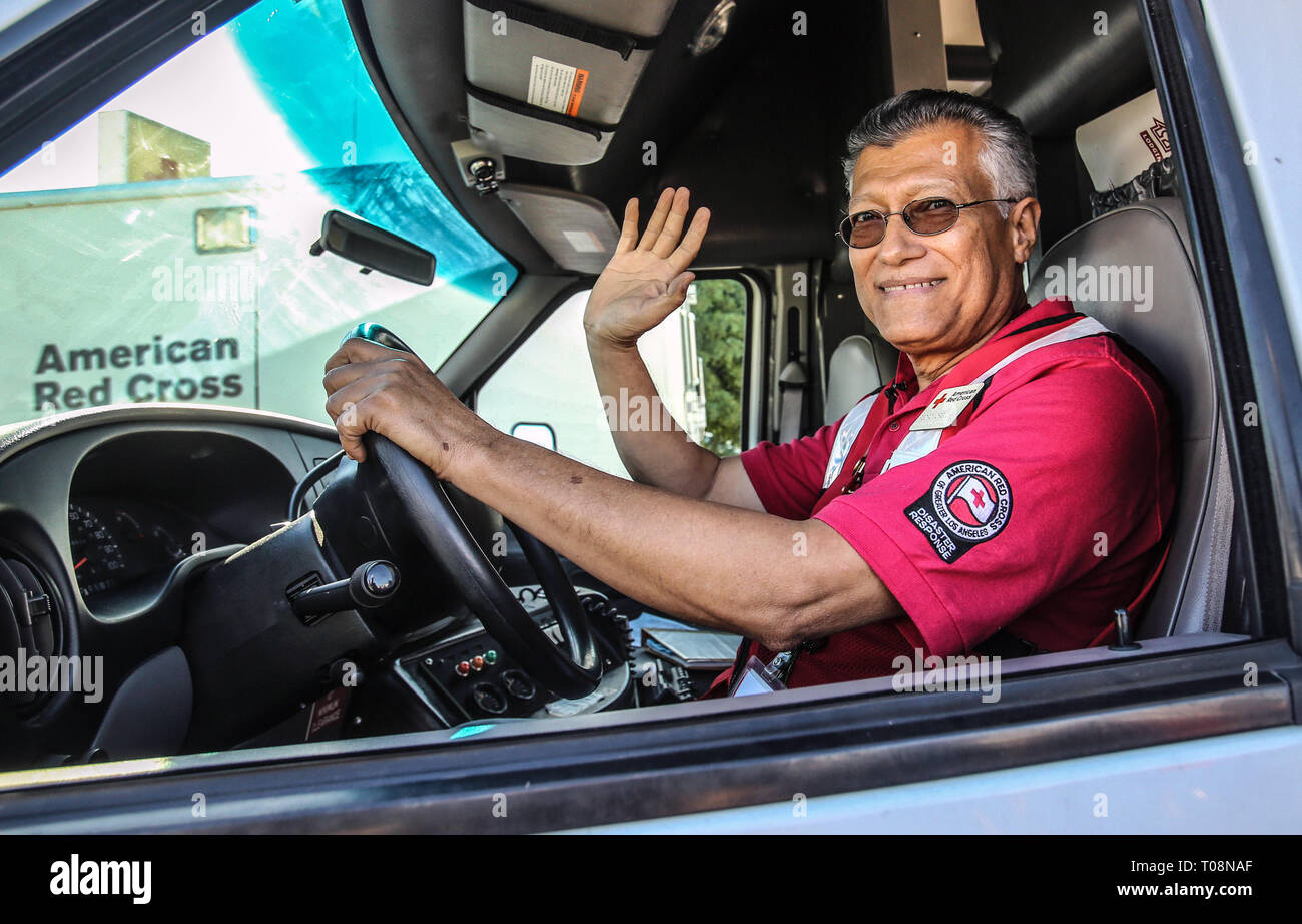 Red Cross volunteer pictured on route to a distaster zone in California - Stock Image