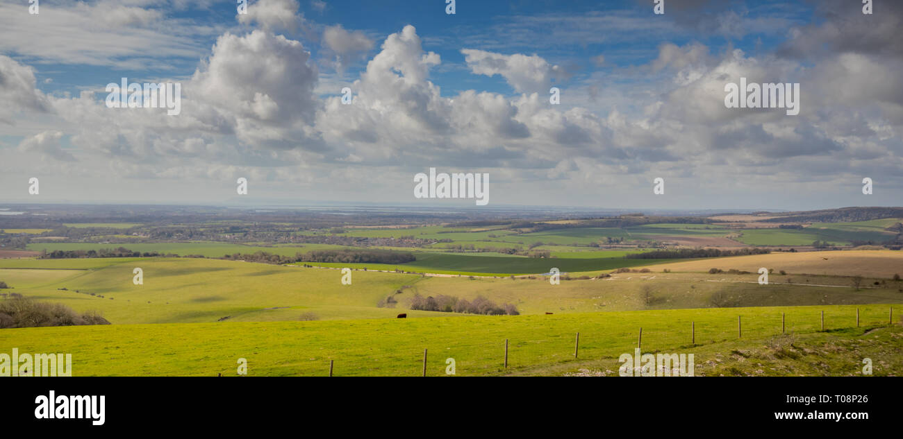 Landscape views towards Chichester Harbour from The Trundle (St Roche's Hill) in the South Downs National Park near Chichester, West Sussex, UK - Stock Image