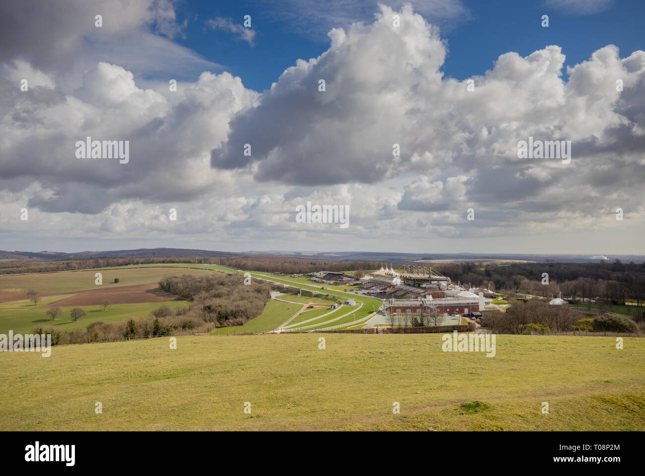 Views towards Goodwood Estate Racecourse taken from The Trundle (St Roche's Hill) in the South Downs National Park near Chichester, West Sussex, UK - Stock Image