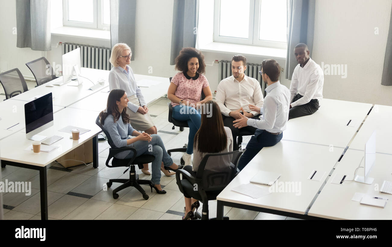Male coach mentor speaking at corporate group meeting, top view Stock Photo