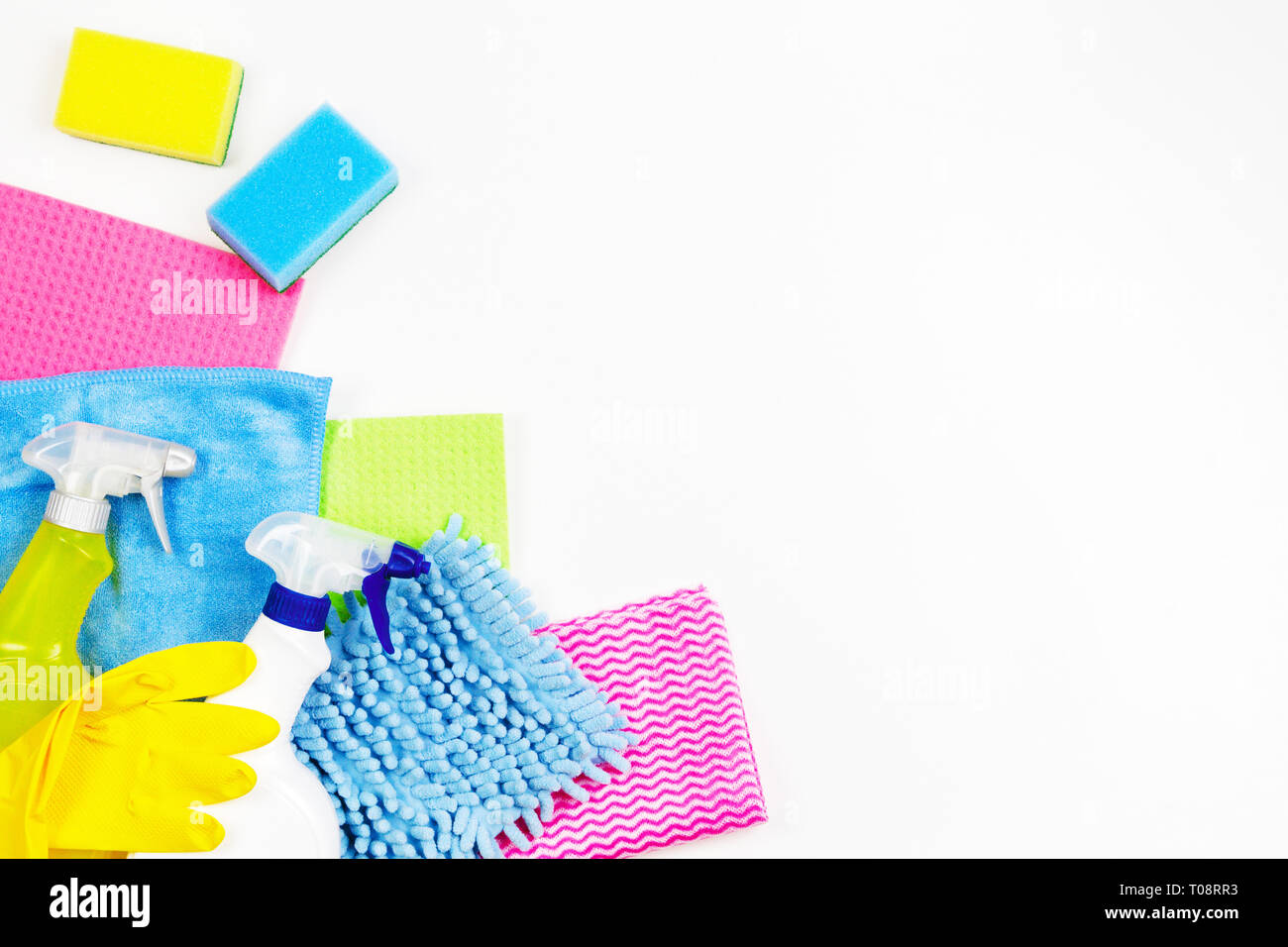 Housework, housekeeping, household, cleaning service concept. Bottles of detergent, rubber gloves, rags and sponges on white background - Stock Image