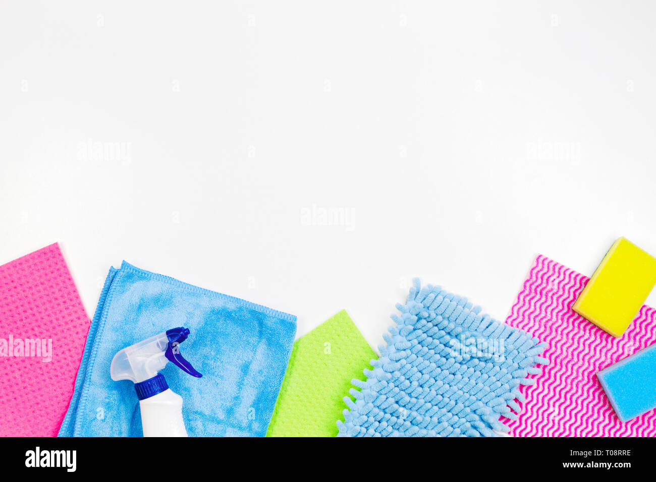 Housework, housekeeping, household, cleaning service concept. Bottle of detergent, rags and sponges on white background - Stock Image