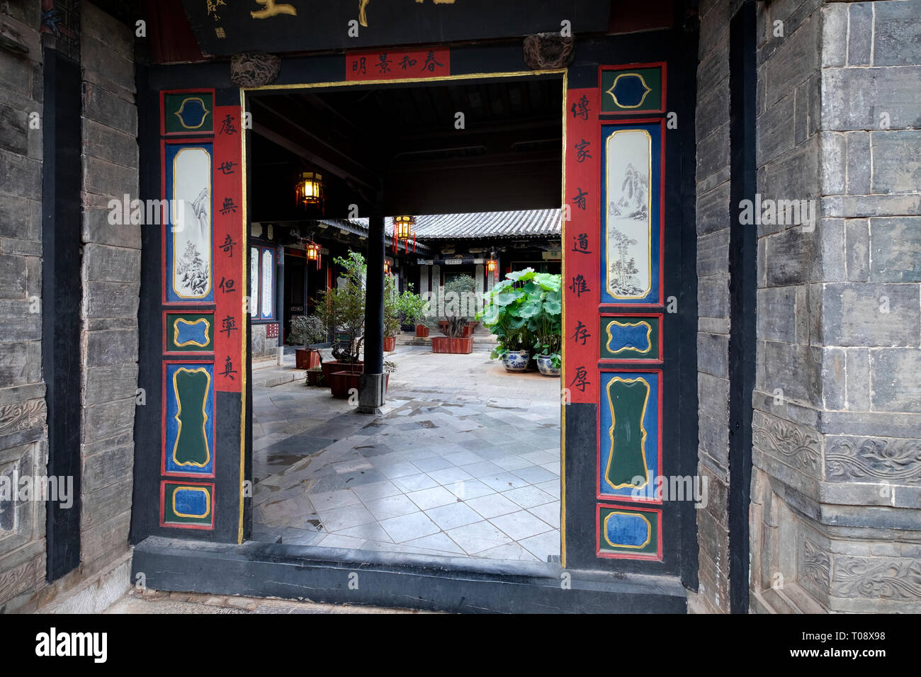 Carved wood doors Interior courtyard, Zhu Family house, Jianshui Ancient Town, Yunnan Province, China - Stock Image
